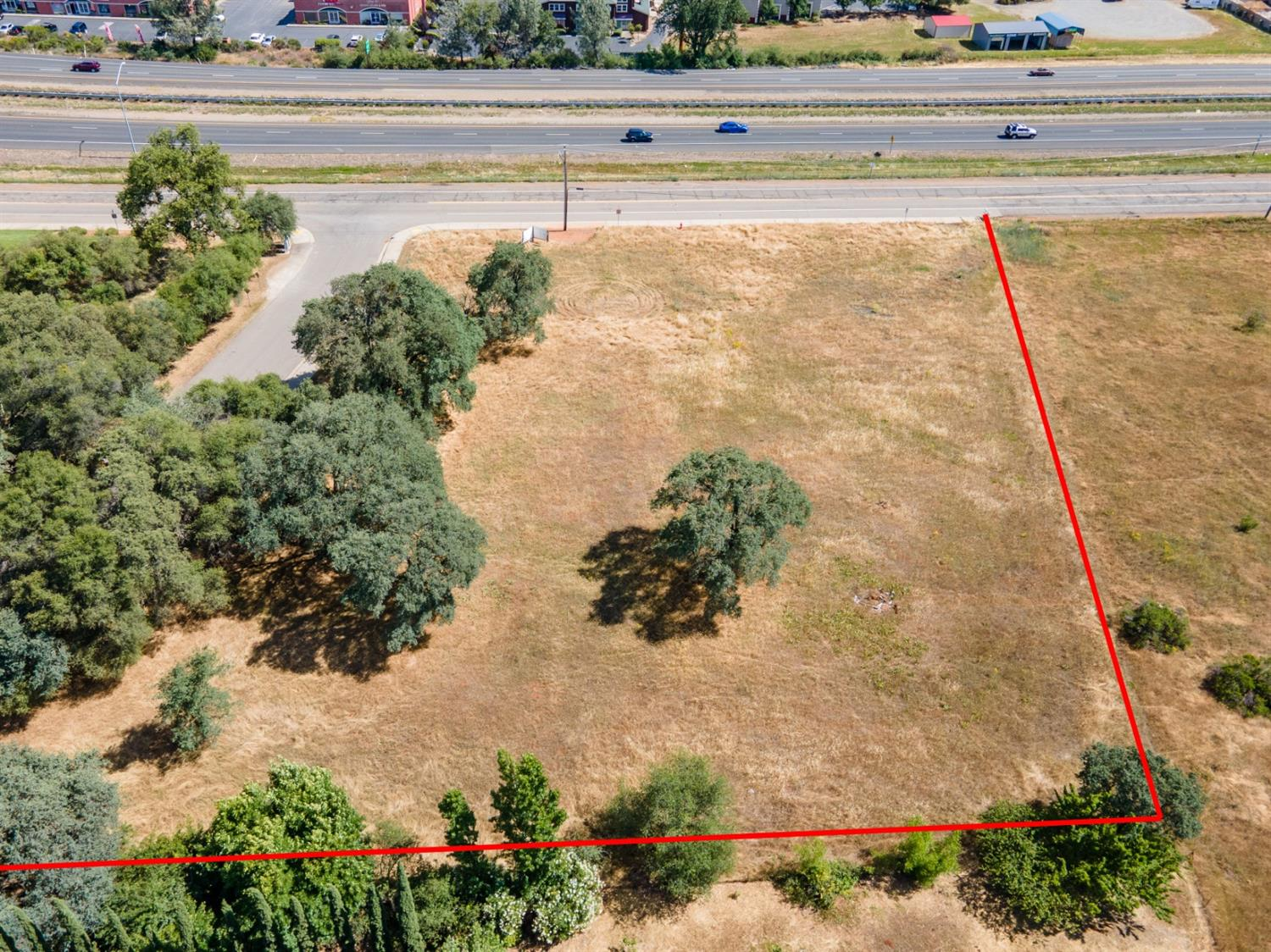TWO ONE ACRES PARCELS TO BE SOLD TOGETHER.VISIBLE FROM HIGHWAY 50 AT THE WEST SIDE OF THE SOUTH SHINGLE AND PONDEROSA OFF RAMP