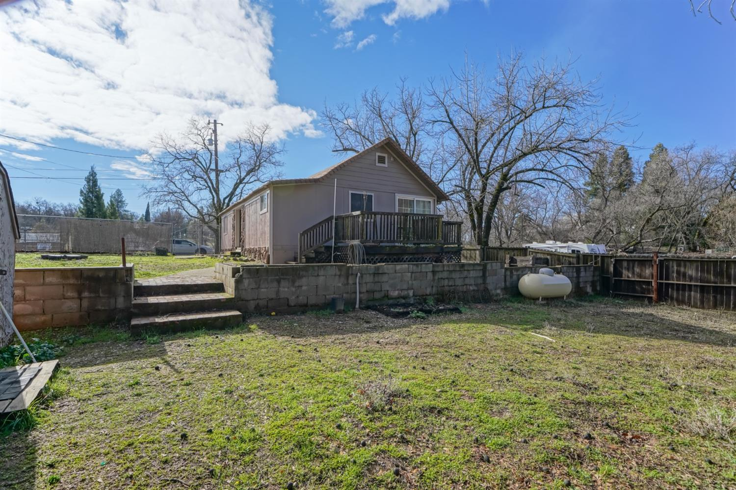SITUATED IN THE QUAINT TOWN OF EL DORADO THE SAME CHARM AND CHARACTER REFLECTS IN THIS CUTE LITTLE HOME -Fantastic potential with multi zoning.  Cathedral ceiling in living room, bright shiny spacious kitchen, 2 nice sized bedrooms with built-in storage units.  Lovely decking, and onsite laundry. Situated on a large fenced corner lot that is two tear and all usable.  Plenty of parking, approximately a block to public transit, grocery store, fire department and some great specialty shops.  Possible daycare, salon, boutique, auto shop, etc.