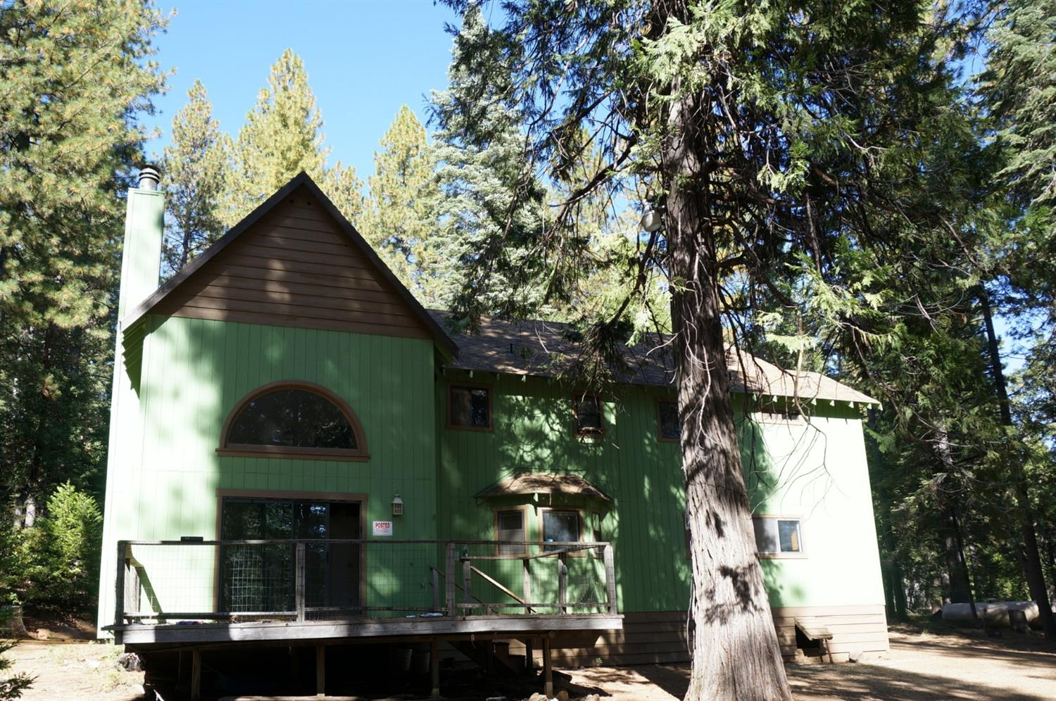 Enjoy the tall pines and privacy! FOUR bedrooms with laundry room Upstairs for convenience. Perfect for a getaway or Vacation Rental. Great layout would make for a great private home!