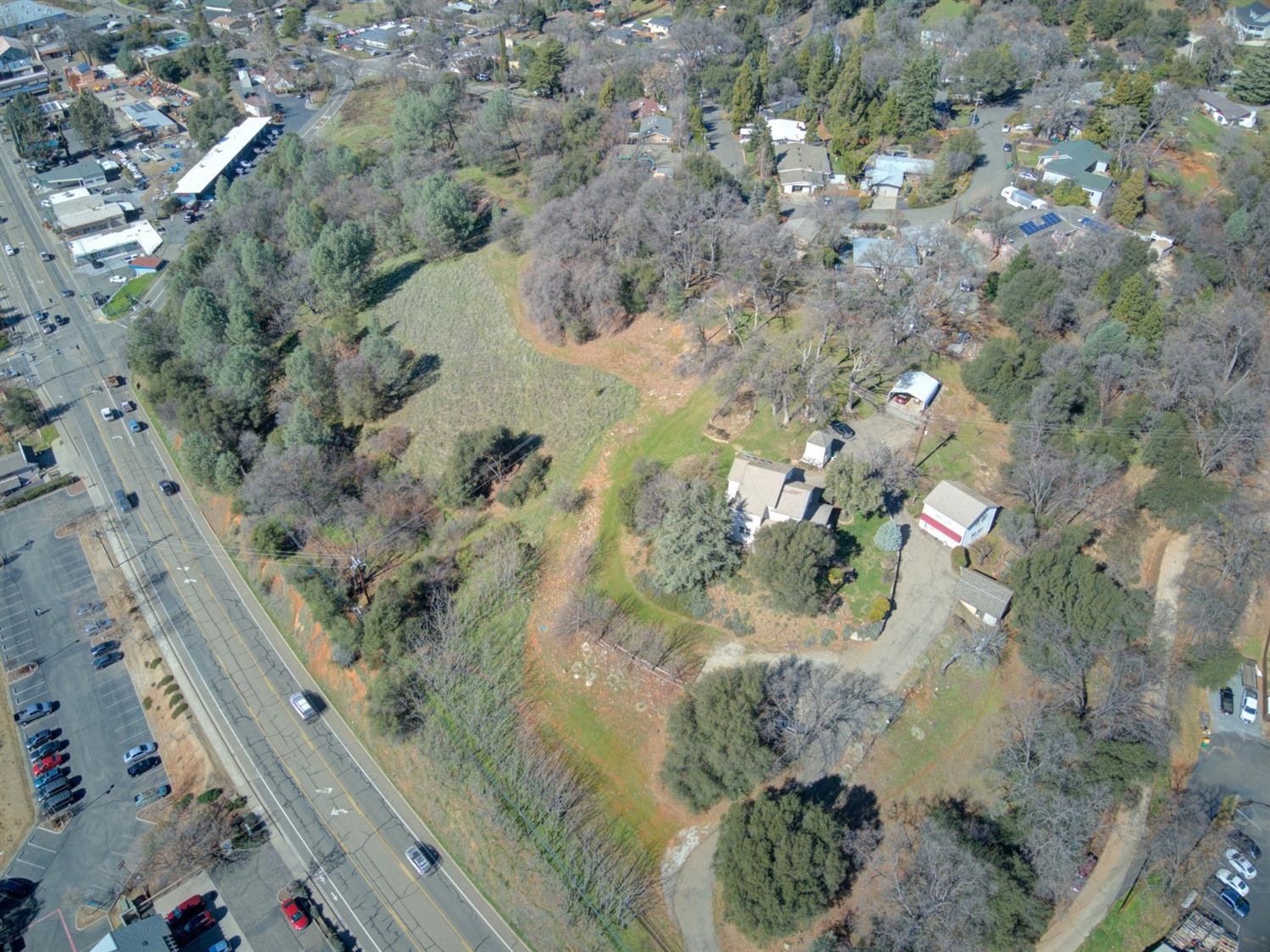 Now with a larger parcel!! CHANGE equals MORE OPPORTUNITY.....!!! Increasing to approx 2.5 acres Of COMMERCIAL PROPERTY---INCLUDING A SINGLE FAMILY RESIDENCE.   You won't be disappointed with this home, property and potential.