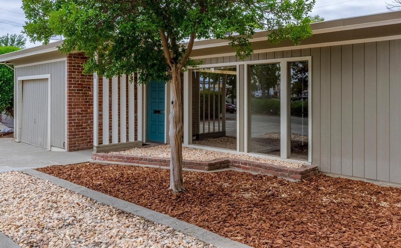 Updated Mid Century Office building. Kitchen has been converted to a storage room, and does not have appliances. Beautiful exposed beam ceilings throughout, new slate tile flooring, and an electric/solar privacy gate. Up to four office suite potential. Front entrance opens to a large open room, that has room to be divided to another office and reception area. Storage room, and more storage available in laundry room. Dual pane windows and central heat and air. So much potential. Great visibility off El Camino. Property sits on a small frontage road, offering easy in and out access. 5 parking spaces, and a one car garage. Nice sized backyard with covered patio.