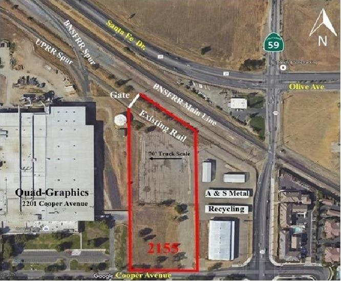 6.2 Acres zoned I-L in Western Industrial Pk. Zoning allows for possible Cannabis related business. 2 APN's 059-450-035 & 036. Located between Quad Graphics (west) and A & S Recycling (east). Has perimeter fencing around most of the parcel and area inside fencing is paved. Rail spur runs through the north end of the parcel. May have potential to  be served by UPRR and BNSF? Was previously used for weighing & grading tomatoes. 70' scale on site (Needs maintenance)