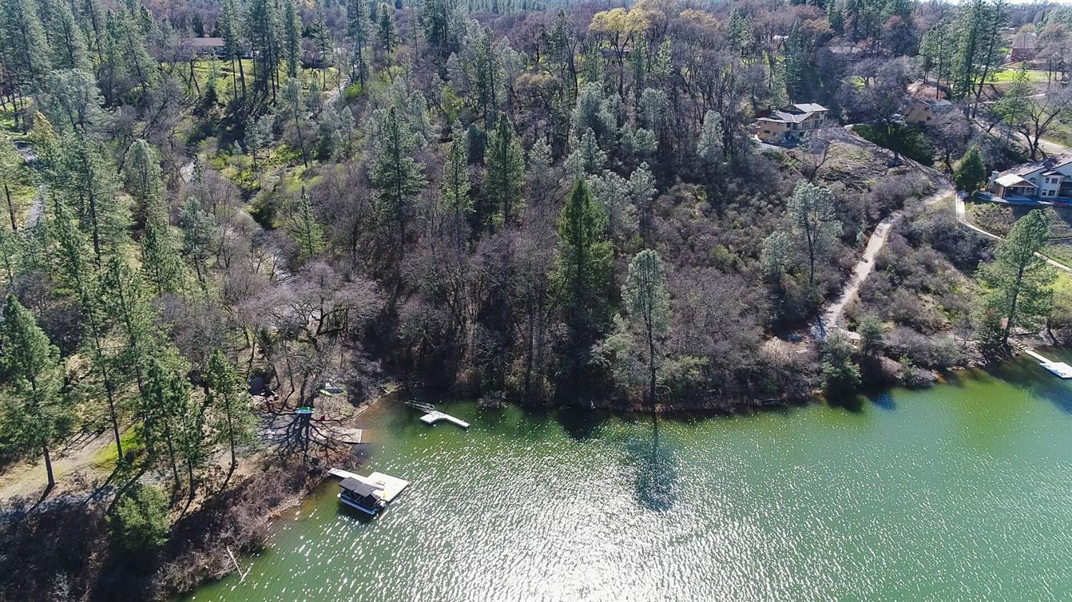 DREAMS DO COME TRUE, not Once But Twice! Rare LAKE COMBIE PROPERTY. Water Lake Frontage, Lake Combie Access, and not just One but TWO PARCELS (sold separately)! Own Both parcels and secure entire lake frontage for privacy, and bring both properties to their Ultimate Glory! This 2.26 Acre Property is a Hidden Gem of Meadow Vista! The neighboring parcel is 3.23 Acres with a Home with Lake Frontage also for sale!