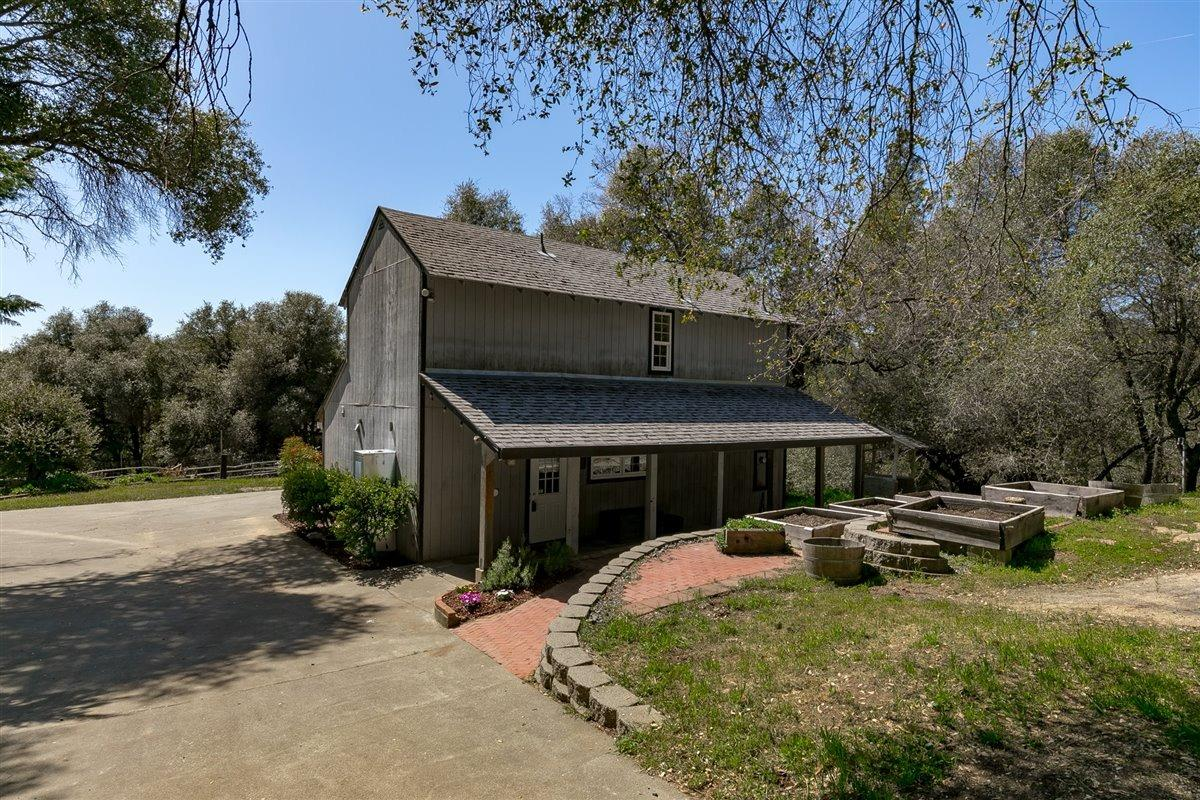Tucked away on a beautiful 5.11-acre usable homestead you will find a recently remodeled 2 bed 2 full bath home PLUS a stand alone Guest Home and detached 2 car garage with 19x13 attached shop. 2 homes on one lot! The vaulted ceilings will catch your attention and the updated kitchen and baths complete the space. From there you can head straight to the sunroom, which overlooks the property with local views. Fully ready for Organic farming. A 6-horse stall barn, arena and horse fencing with multiple pastures and garden beds, plus a ready to finish greenhouse are all part of the Ranch. The Cosumnes River flows within a short distance from the property and provides private recreational access with a beach and picnic tables- hello summertime! T