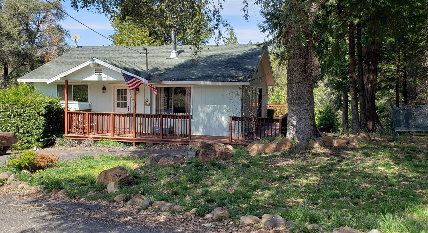 Life in the foothills among the trees! 2 levels with attached garage. Upstairs remodeled a few years ago.Upstairs is opened living area, kitchen, 2 bedrooms and full bath. Downstairs has family room, 2 bonus rooms (used as br's with no closets) Laundry area and interior access to garage. 2 water sources, well and natural spring maintained and shared with several neighboring properties.Sale includes 3 apn numbers 0021111012 0.29,021111006 0.636, 012-111-013 1.189 acres. total 2.1, Great get away with lots of sleeping area or cozy for a family.