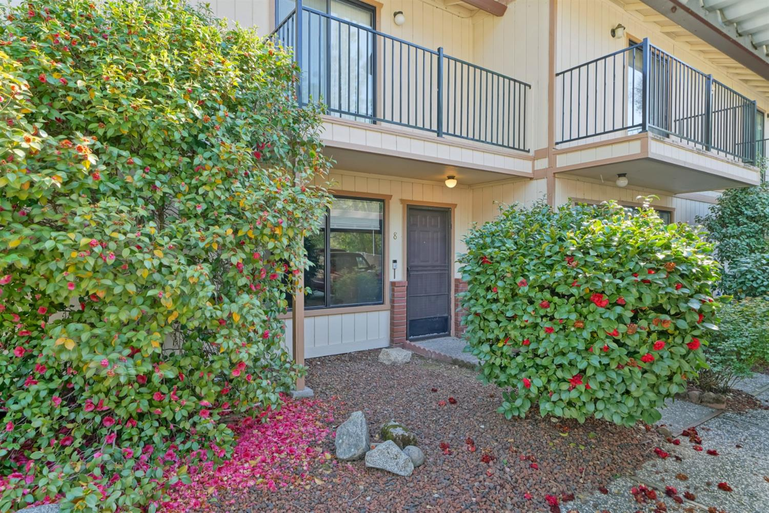 Quaint 2 bedroom, 1.5 bath condo in Lakeview Village, perfectly located in close proximity to shopping, restaurants & Hwy 50 access. Cozy family room with wood burning stove, updated tile flooring in living areas, & half bath downstairs. Upstairs features 2 spacious bedrooms, balcony off master bedroom, full bathroom & laundry area. Low maintenance private yard. Condo is assigned one covered parking space & one uncovered parking space.