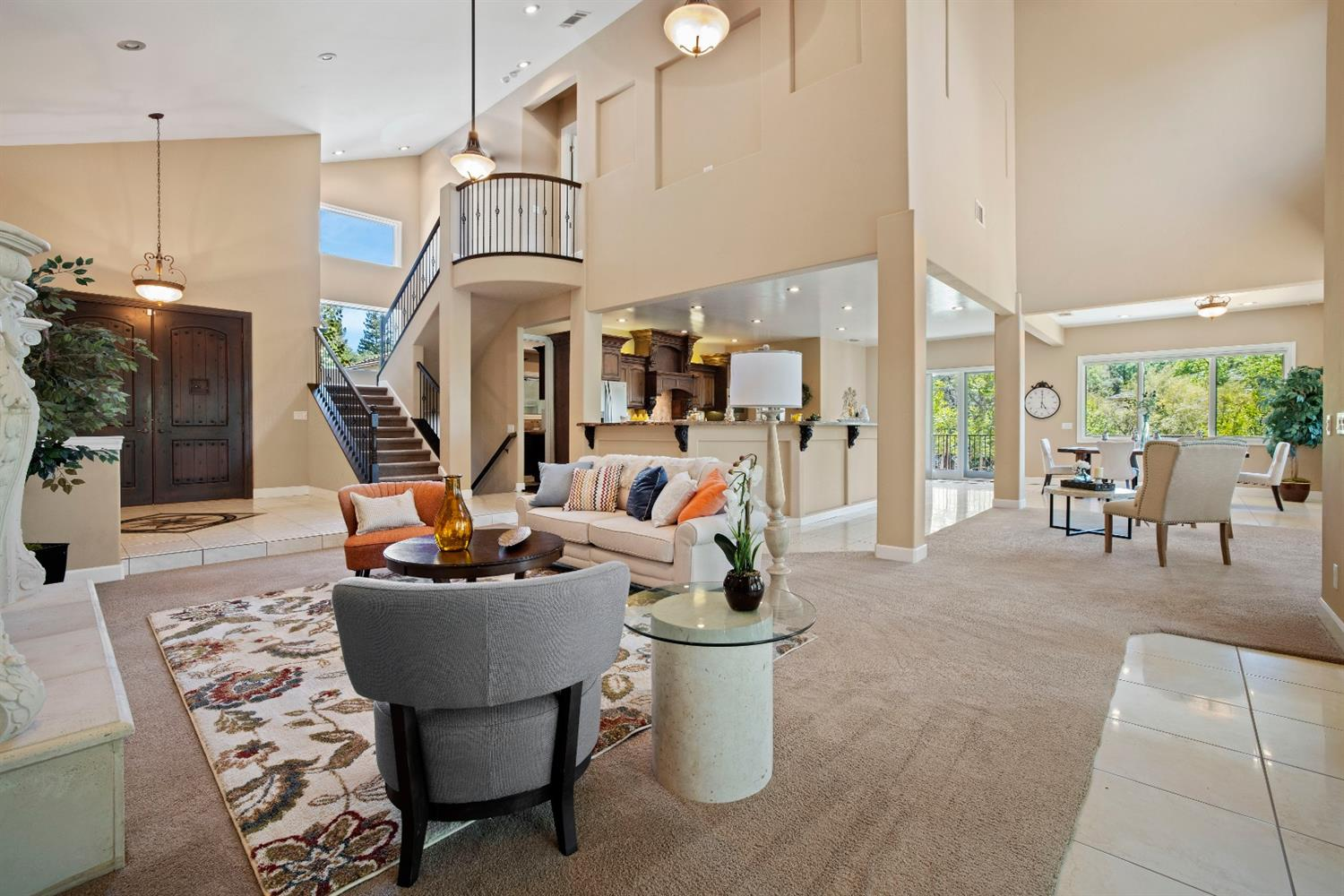 View of front door, formal living room, stairs to master bedroom and kitchen and formal dining room.