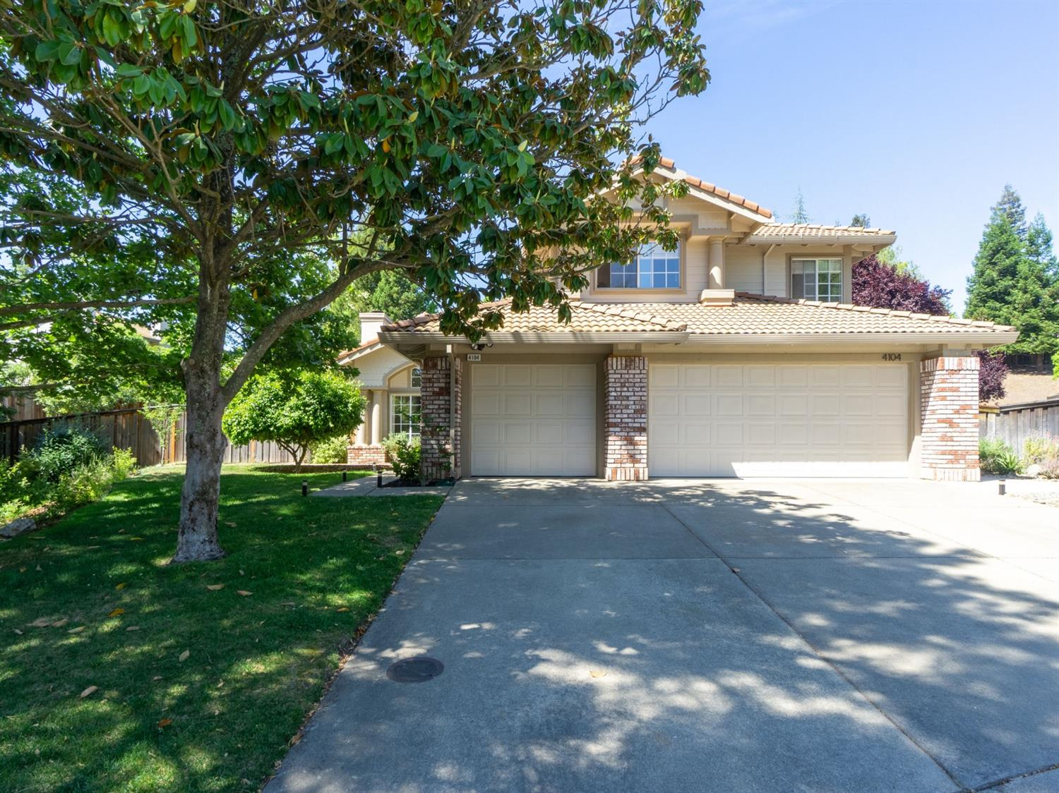 Situated in the desirable Green Valley Hills neighborhood on a Cul-de-Sac close to great schools, community parks & Folsom Lake. Gracious 4BR-3BA home with an updated retro style featuring cathedral ceilings, 3 fireplaces, newer flooring, lighting, & hardware, interior shutters. The updated kitchen boasts Bosch double ovens, Wolf induction cooktop, updated cabinets & fixtures, retro chandelier in nook, granite counters & dining bar. Huge family room w/brick fireplace & beverage bar. Updated ground floor bed/bath. Master suite: fireplace, huge closet, enclosed shoe storage! Abundant storage & deep sink in laundry rm. Big 3-car garage w/workbench & cabinets. Sun Room is a fab informal space for games & entertaining! Backyard Paradise! Relax i