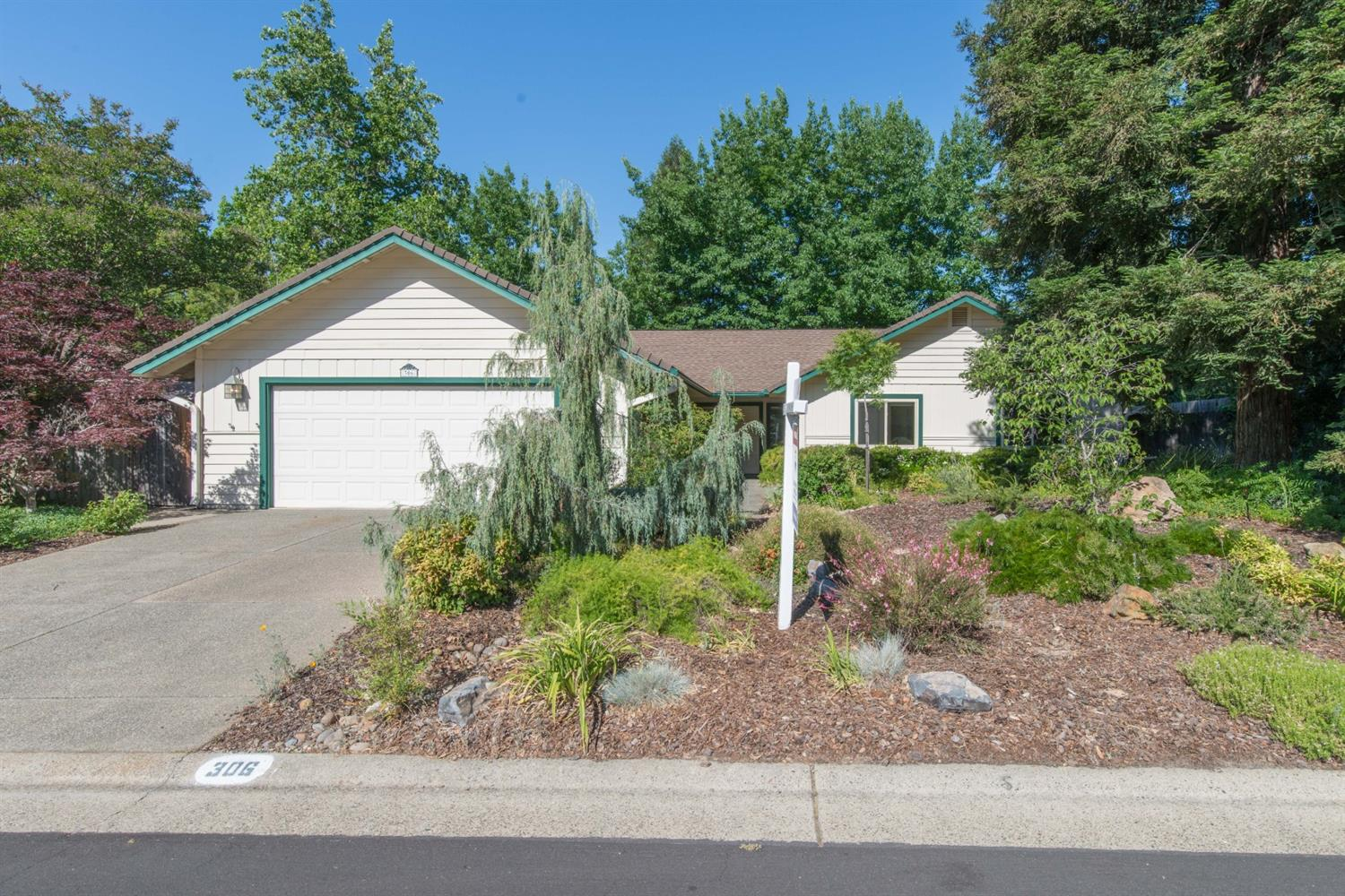 Single Story in Folsom's established & sought-after American River Canyon neighborhood! Decorated with warm earth-tones throughout, and nestled in a park-like setting, this classic home has such an inviting feel. As you walk in, you will find a sizeable living room that transitions to a formal dining area framed by an eye-catching brick wall. From there, you can enter the kitchen directly, or pass into the daily dining area and cozy family room fitted with a pellet stove, and a gorgeous vaulted wood ceiling and skylights. The well-appointed, well-lit kitchen has several points of interest: peninsula, garden window, and glass-inlayed upper cabinets. At the opposite end of the home, you will find 2 spare beds, 1 full bath, and a large primary