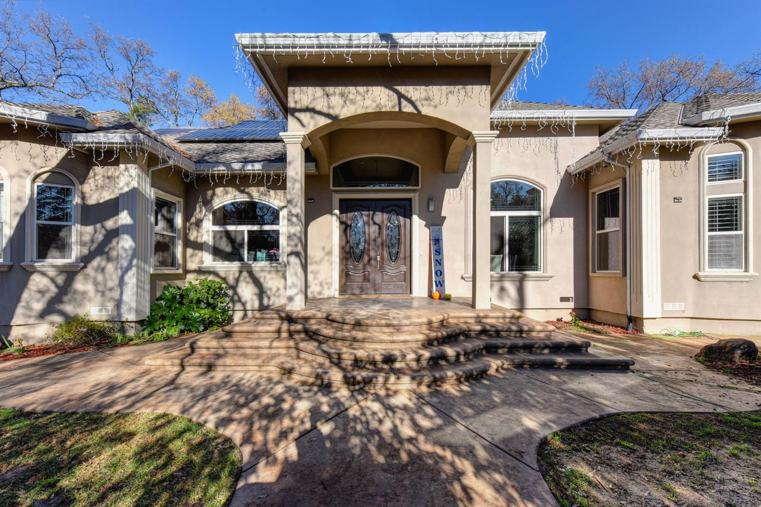 TWO HOMES on one lot in GRANITE BAY! Main house is a single story 3,500 sq ft home w/ 4 beds plus office, 3 1/2 baths & guest house is 750 sq ft. Baths have been remodeled. A 7KW, OWNED SOLAR system installed 2 years ago! New furnace recently installed. LED recessed lights throughout w/dimmer switches, Watchdog security system w/8 cameras, 5 motion sensors, each window & door has a sensor as well. Gourmet kitchen boasts cherry cabinets, granite counters, SS high-end appliances, built-in refrigerator, & new 6 gas burner stove. New paint throughout. 2nd home is 2 beds, 1 bath, family room, separate laundry room w/outside access, enclosed patio deck off family room sliding doors, new quartz counters in spacious kitchen, dining area, fireplace,