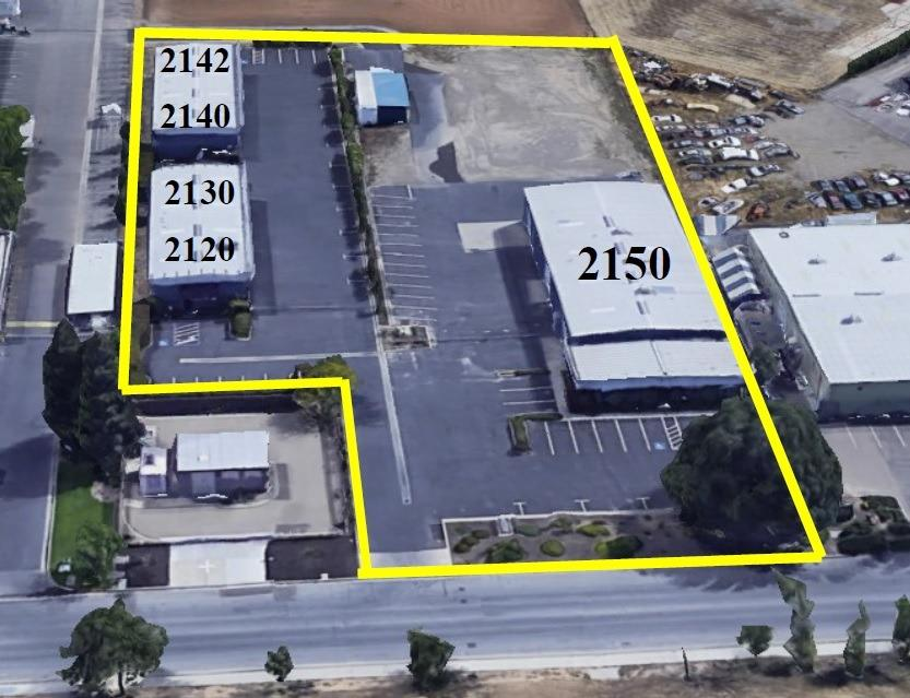 3 buildings on a 2.3 acre parcel. 2 bldgs on the east side of parcel are both 4,000 SF and each is split into 2,000 SF spaces. Flooring company occupies 3 spaces (i.e. 6,000 SF) 2120, 2130 and 2140 & a plumbing company occupies the 4th 2,000 SF space. All of the buildings are fully insulated and have skylights for natural lighting. The western Bldg is 9,000 SF, is fully sprinklered, has 1,500 SF of nice offices with HVAC, 7,500 SF of shop with gas fired space heating/evaporative cooling and has 4 roll-up doors. 2150 has its own fenced & gated yard area most of which is paved but some is hard packed road base. 2120, 2130 & 2140 leased to Flooring Company, currently paying $3,713 / month and rent increases 3% / year on April 1st of each year.