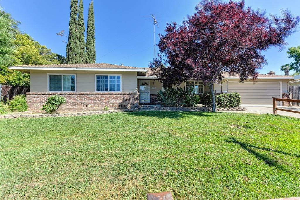 Privacy Plus.Well maintained home with recent  painting in and out. Parque flooring in main rooms.  Most rooms overlook parklike yard with huge shade  trees,30x15 greenhouse& pool. Many fabulous roses& .raised flower  beds and fruit trees. Dog run and 7.5X25 poss.rv   space. Finished garage.