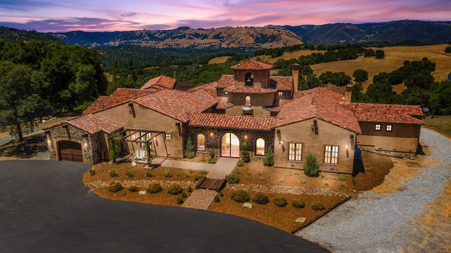 Welcome Home to this spectacular and private custom-built(2011) Mediterranean-infused, SINGLE STORY 6043sf home on almost 23 acres with absolutely stunning views! This home was meticulously crafted from natural elements and reclaimed history from around the Sacto region. Too much detail to list all: 4 bedrooms all ensuite, built-in wet bar, rec room, theater room, wine room. Custom wood and iron workings throughout with many Italian plaster accent walls. Radiant floor heat. Back-up generator for main house. Built-in pool & spa, firepit and large poolhouse which includes kitchenette, vented BBQ area, full bath. 1-car garage attached to main house with electric car plug-in, 4-car detached garage, HUGE 2800sf shop w/RV storage for your car collector client. 5 acres have been rough-ripped around the main house for a vineyard. This property is gated and fully fenced with a small cross-fenced area. Truly an one-of-a-kind entertainer's dream home with so many possibilities. No HOA's or CC&R's