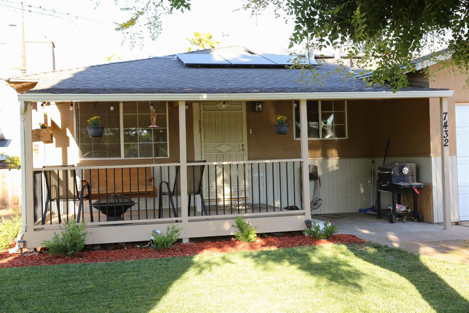 Welcome to your new home! Sit on the porch swing under the tree shaded lot near a beautiful communit