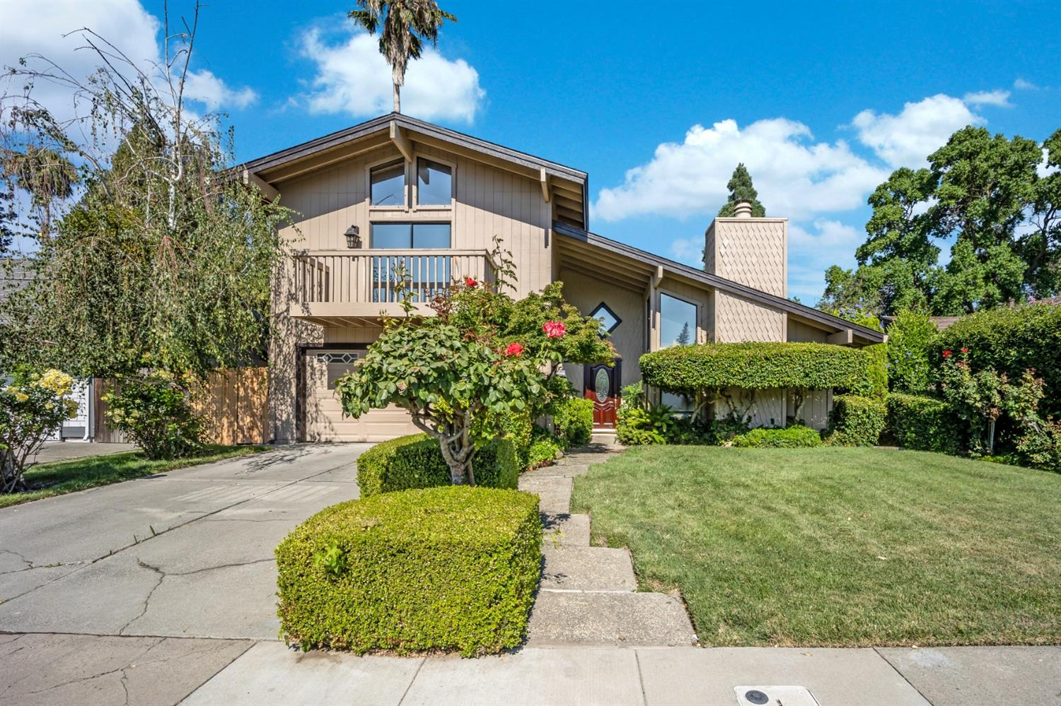 Welcome to an open, spacious tri-level home in the heart of the Pocket. The Pocket is one of the premiere communities in all of Sacramento with some of the best schools in the county. Pulling up to the home, you'll find it's well landscaped and clean. Stepping foot inside, you're welcomed into a home full of light, with large open spaces and vaulted ceilings. The living room upfront is designed for entertaining, as it features a large sitting area overlooked by a separate dining area. The first floor features eye-catching, polished, travertine floors with laminate on the elevated floors for durability. Upstairs you'll find an incredibly large master suite complete with a balcony to enjoy the sunrises or evening breezes, as well as the two additional bedrooms and renovated bathroom. The real star of the show is the enormous and fully landscaped backyard.  The vast backyard and open downstairs area make this home perfect for entertaining, and spacious enough for even the largest family.
