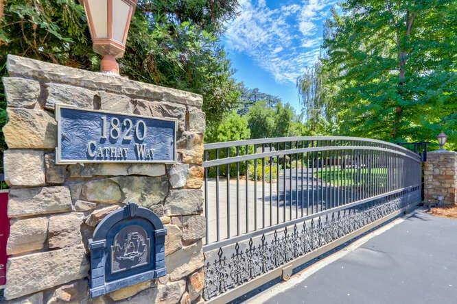 Prestigious Arden Oaks flowing ranch style home elegantly updated & appointed with fine finishes befitting estate quality homes. A double gated circular driveway introduces this charming home with 5 bdrms, 3 Full LUXE Baths, light filled rooms with French doors, walls of windows & huge skylights! Crisp smooth white walls are complimented with rich dark hardwood flooring, white marble kitchen counters accented with contrasting dark wood and white cabinetry. A cache` of high end appliances include both WOLF Gas & Induction cooktops, 2 ovens, 1 electric, 1 steam/ convection, Subzero refrigerator and several refrigerator & freezer drawers. There is both a Coffee/Beverage Bar & A Wine Bar with 2 Subzero wine refrigerators. Enjoy your private oas