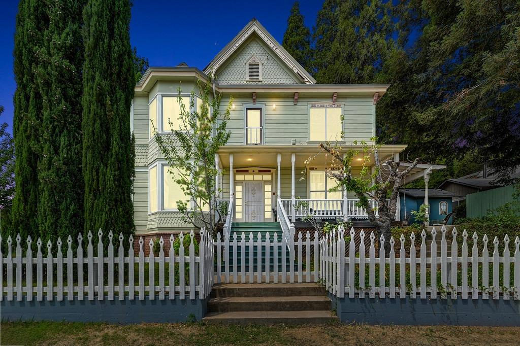 This Historic Colfax house sits at the foot of the Big Hill over looking Colfax. Originally constructed in early 1897 and built by Judge Jacob Kuenzly formally of Switzerland. Victorian Architecture design consists of approx 2600 SF with 4 bedrooms and 3 full baths. Entry Hall leads to formal dining room with built in glass & wood hutch & plenty of windows and formal living room, bay windows & adjacent study with gas fireplace. Nice kitchen for informal dining and off the back side of kitchen we have the butlers pantry or library. Full size utility room & full bath. One of the Main suites has an adjoining Solarium sun room with a full walk in closet, plus a step in closet. Many features through out: updated baths, crown moulding, oak hardwo