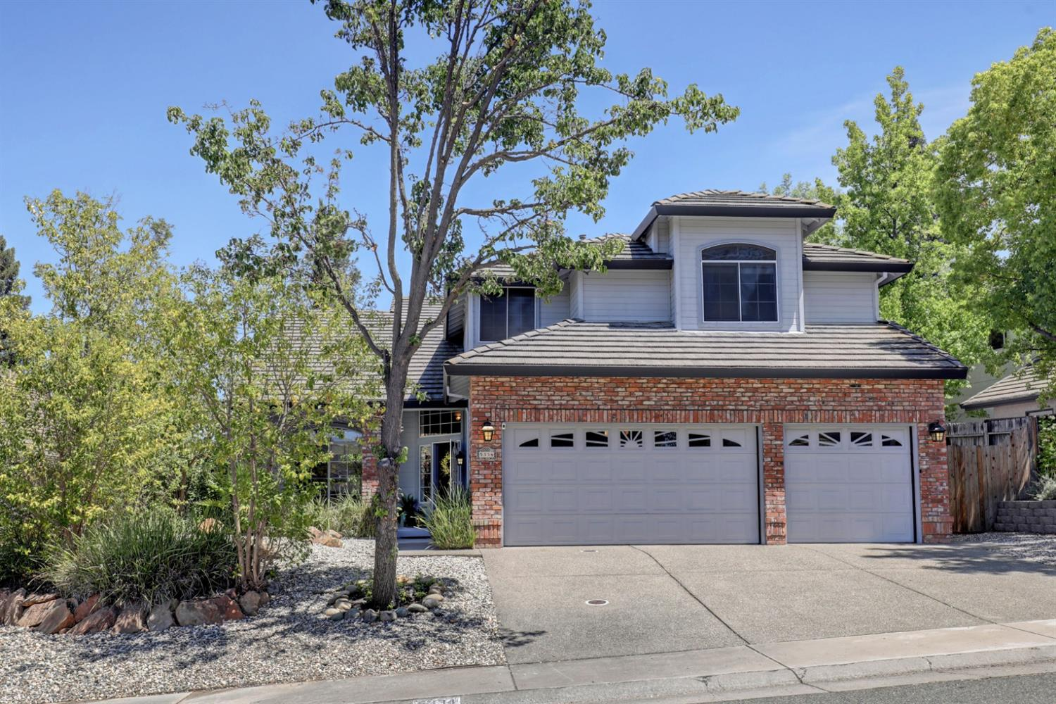 Located in the community of Phoenix Field where pride of ownership is evident!  Formal living and dining rooms and large chef's kitchen that opens to the family room.  Kitchen has island with sink as well as wet bar with sink - great for entertaining! Downstairs has 4th bedroom with full bath near- great for multi-generational living! Upstairs enter the large master suite with sitting area, fireplace and balcony.  Relax in the jetted tub by the fireplace.  New carpet throughout and vinyl tile flooring in kitchen.  Backyard is low-maintenance with garden area and putting green. Backyard mature fruit trees include apple, kumquat, lemon and lime.  Close to Little Phoenix Park, 64-acre Phoenix Park and the American River Parkway.  WELCOME HOME!