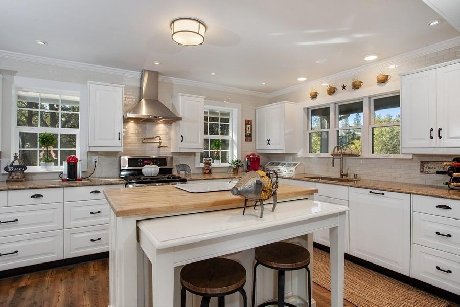 """Fall in love with this beautiful home on 2.1 wooded acres in Colfax. This immaculate home feels like new! The fabulous kitchen with quartz counters, SS appliances, 5-burner stove with griddle burner & pasta pot faucet is perfect for the gourmet chef! Butcher-block island has a clever slide-out table feature for extra seating. Remote master suite with separate stairway is a peaceful haven. Master loft space could be used for an office, craft area, workout room or converted to a fabulous walk-in closet! Updated throughout with meticulous attention to detail including crown moldings and much more! Large covered front porch and spacious back deck give you plenty of room for outdoor enjoyment. 10-year young roof and Leaf Guard brand gutters. Low maintenance natural environment. 1"""" PCWA irrig. water. High garage doors to an over-sized garage that is deep enough for shop space. Plenty of room for RV parking off the circle driveway. Only 1 mile from the City of Colfax for schools & shopping."""