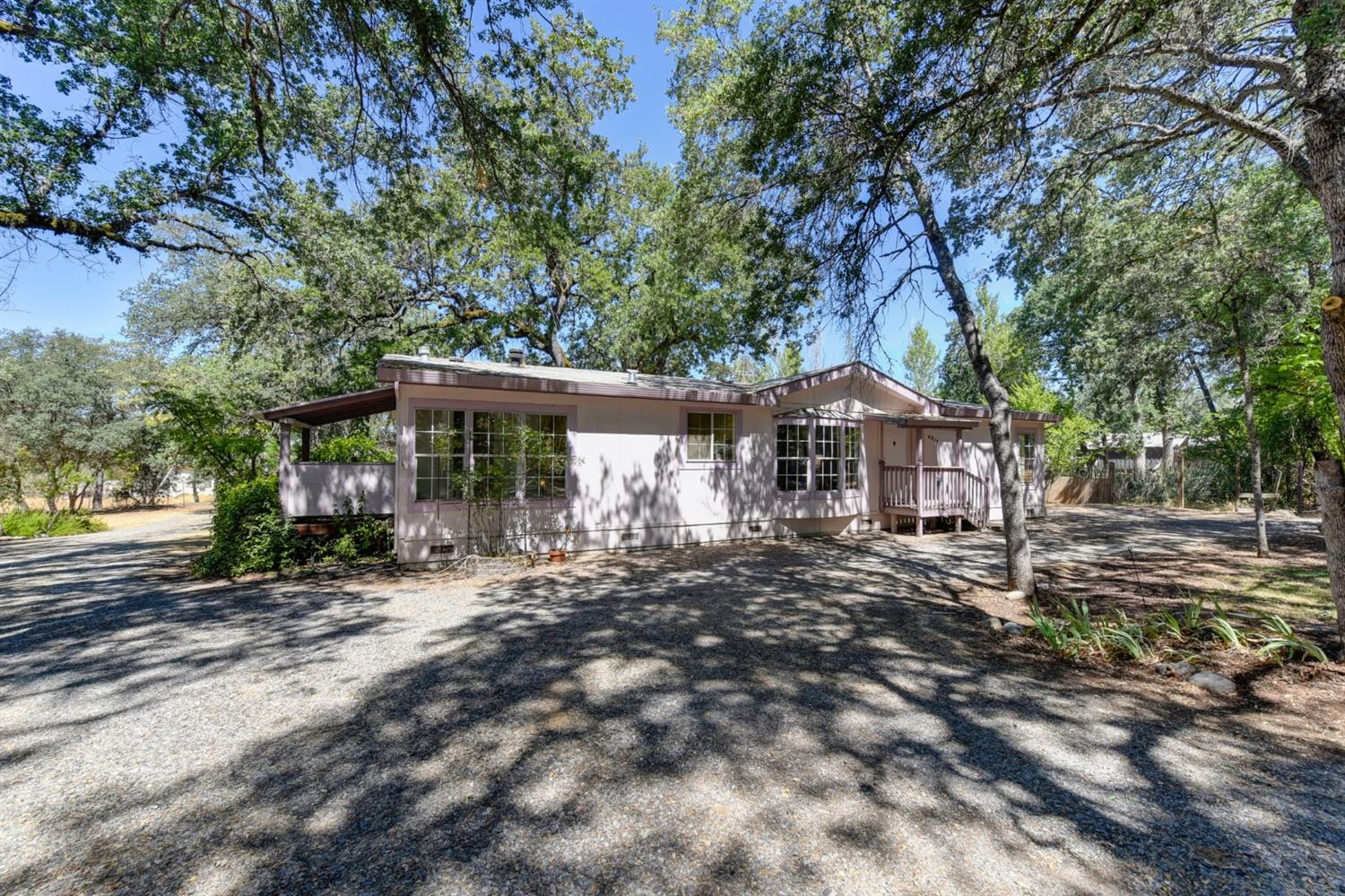 Rare Find. Single level home, with an Approximately  1500 sq. Ft. Garage/shop with upper level. Would be an easy conversion to a granny flat or ADU. Almost 2 acres of Flat land is perfect for animals or a garden. Close to the Town of El Dorado. Cosmetic fixer, do your own work and gain some sweat equity. Several out building offer lots of extra storage. Two ways to enter, make it easy if you have a RV or large vehicles. Hurry, this won't last.