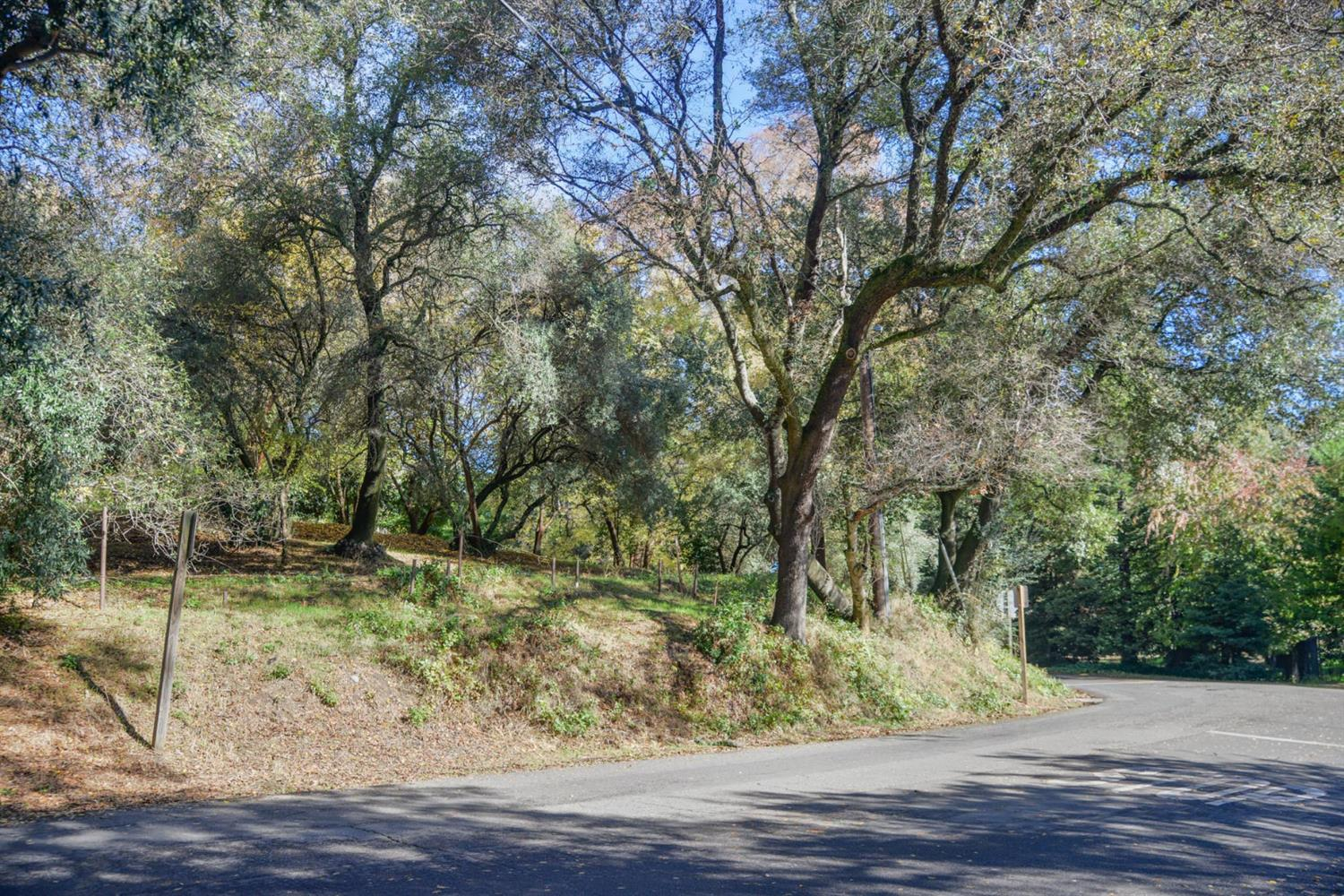 Outstanding lot ready for you to build the home of your dreams! This lot is perched above the corner of Pennsylvania and Magnolia, right at the entrance to the American River Parkway trail! There is a potential building pad of approximately 2,480 square feet! Trees and potential views, plus on site water make this lot very desirable! Come enjoy the special features of living in Old Fair Oaks right by the river!