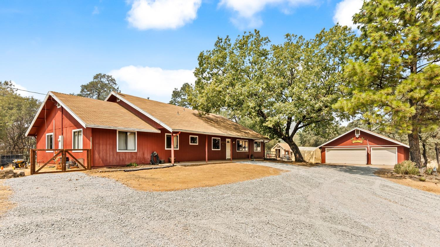 This Ranchette on 4.99 acres offers gorgeous views, spectacular sunsets and gentle, usable acreage. Versatile open floor plan offers a family room w/warm wood stove, a spacious kitchen w/pantry, formal living & dining plus a bonus room w/outdoor access. Could be in Law quarter or home school classroom. Outdoor living complete w/pergola covered patio, room to roam. Fenced, cross-fenced & gated w/a tool shed & an oversized 3-car garage w/220v. Boasting an Ag well, public water -Homestead ready, bring all your animals. A slice of heaven w/privacy, majestic oaks & a serene setting 15 minutes to town. 10-15 minutes to nearby American River swimming holes. Under an hour to Tahoe.
