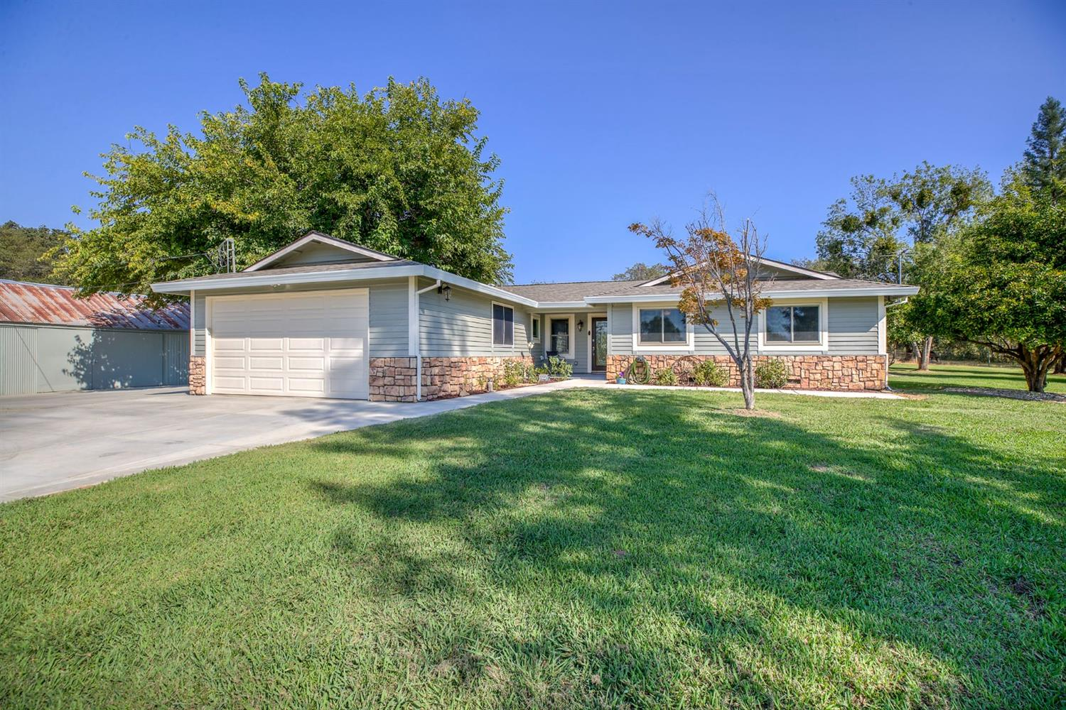 The work here is done! Recently updated single story home on 7.5 acres! Park like setting with 1/4