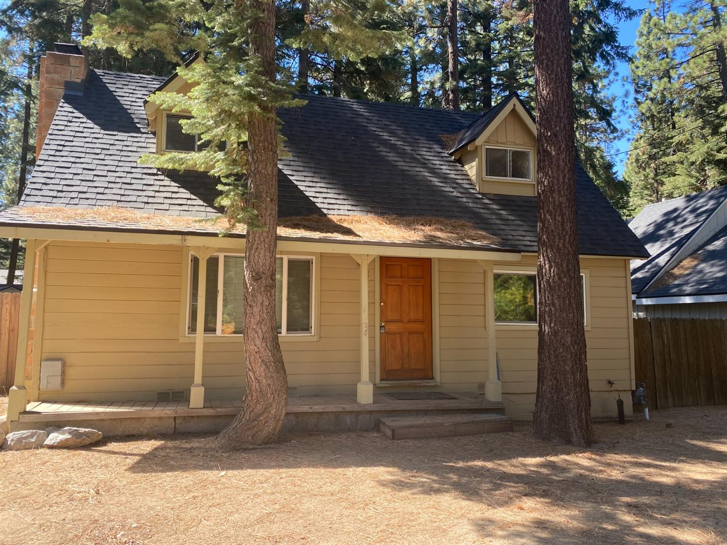 First time on the market in over 40 years!!!! Make this cabin your home, family get away or use as a rental property. The opportunities are endless. The home offers a quaint kitchen with stove, oven and fridge. Knotty pine kitchen cabinets and walls through out the main level. Upstairs is the two bedrooms. Sip your morning coffee on the covered front porch. The spacious fully fenced backyard is perfect for family gatherings. Enjoy all that South Lake Tahoe has to offer, Skiing, shopping, hiking, biking, taking a ride on a snow mobile or just relax on one of our many beaches.