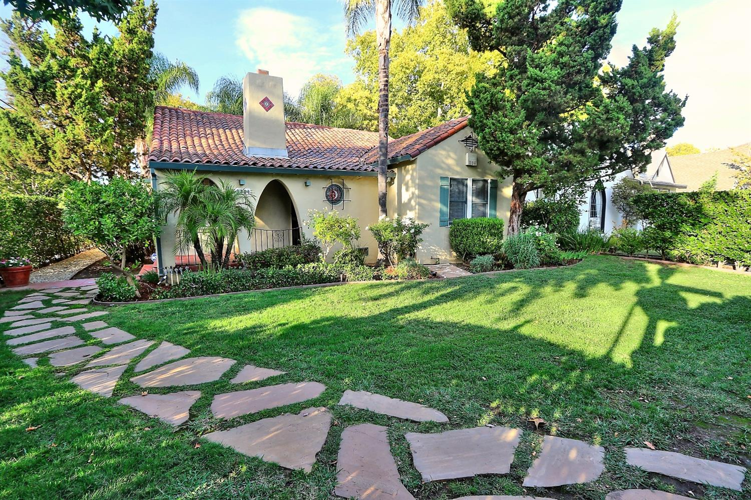 Beautiful 1929 Spanish Colonial in Curtis Park! This well maintained property has all the Traditional Spanish Charm with open beamed ceilings, arched doorways and leaded glass windows.  Master suite with private bath and skylight - Plus 2 large bedrooms and 2nd hall bath.  Bright kitchen with casual breakfast area and formal dining room looking out the french doors to the tiled courtyard. This corner lot allows for a nice big yard complete with water feature and space for a garden. Don't miss the quarter basement perfect for storage or a wine cellar. Washer/Dryer & Refrigerator stay