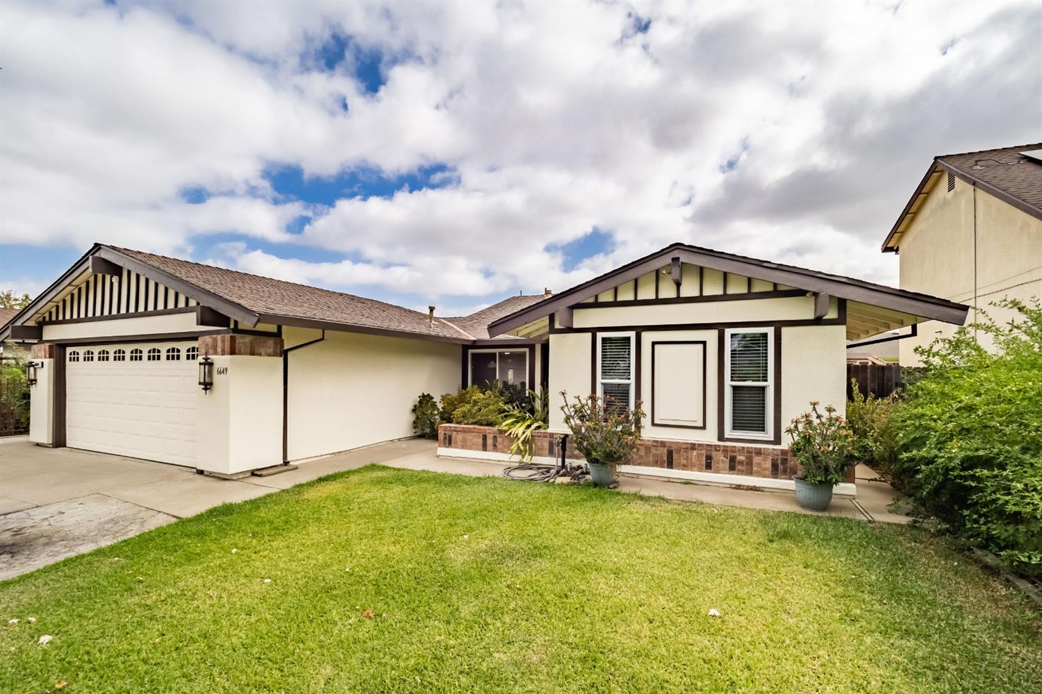 This wonderful 4 bedroom 2 bathroom home features a living room with separate family room, a wide pa