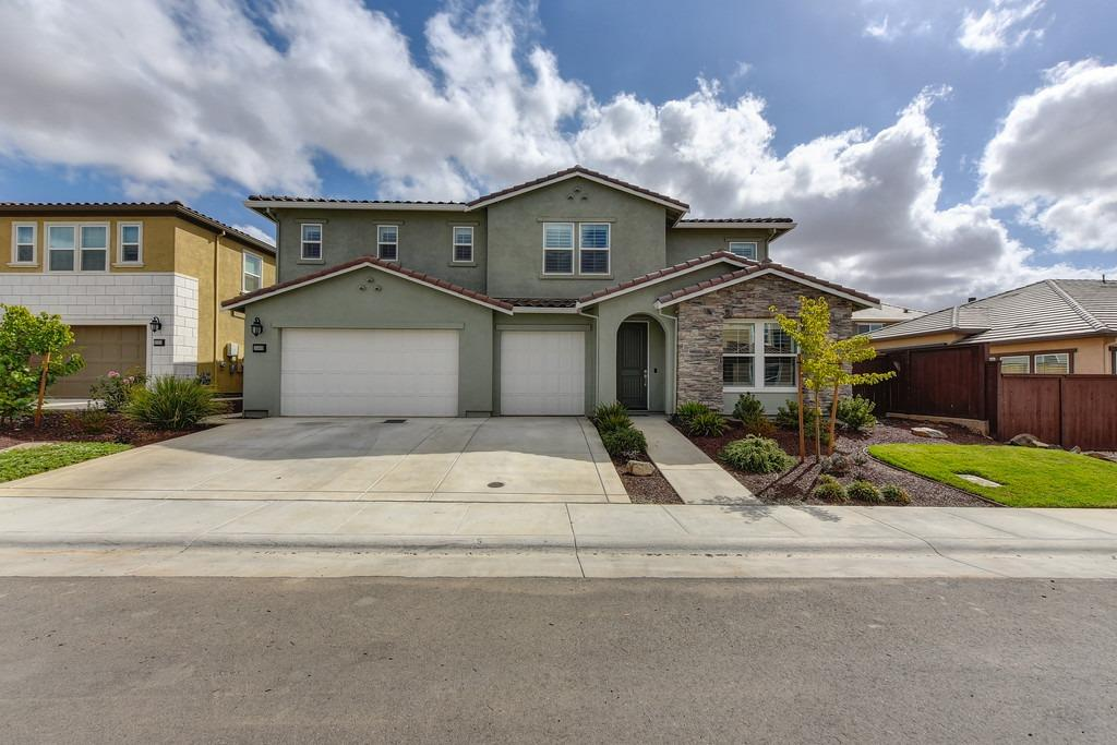 This house is 2 years old and has barely been lived in. This shows like a model home!  The seller has put over $200K in upgrades.  $150 pool/spa, BBQ island with grill and smoker.  The backyard is fully landscaped, $25K in office cabinets & garage storage.  Plantation shutters throughout, closet organizers, exterior was just repainted.  Home also features a downstairs en suite.