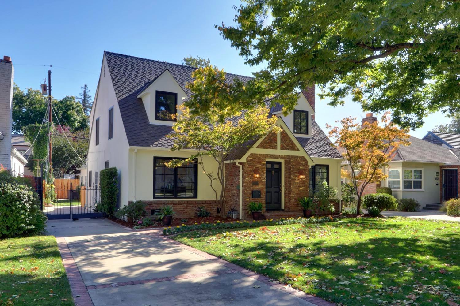 Welcome to 2777 Land Park Drive! This recently updated home is located in one of Sacramento's most coveted neighborhoods. The beautiful brick Tudor exterior has new custom black wood windows and is freshly painted. Upon entering the home, you are welcomed with a large living room, gas fireplace, inlaid hardwood flooring, and detailed trim ceilings. The updated kitchen has plenty of cabinets and counter space and a lovely view from your kitchen breakfast table. Off the kitchen, you will find a large formal dining room with views of the brick patio through the french doors. The family room, with a wood-burning fireplace, could also work as a downstairs main bedroom with a full ensuite bath. Upstairs you will find four bedrooms and a full bath with a separate shower and tub. The big bonus with this home is the newly built guest home (ADU), meticulously designed for optimum living. The location is outstanding, offering a wonderful community, schools, William Land Park.