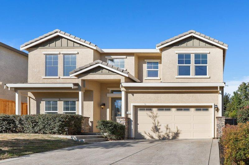 RARE FIND in Fair Oaks! Gated Community with only 12 Semi-Custom homes, built in 2016. Room for the entire family AND guests, with 5 bedrooms and 3 full bathrooms. Main floor includes one guest bedroom, a full bathroom and laundry room. This home also features two-story ceilings, a large and spacious open-concept kitchen/great room, granite countertops in kitchen and all bathrooms, stainless steel appliances and tankless water heater. All of the bedrooms are a generous size, including the owner's retreat and ensuite with dual vanity, soaking tub, large shower and walk-in closet. Great schools, shopping, American River access and rec center, bike trail, Highway 50 and only 10 minutes to Lake Natoma.