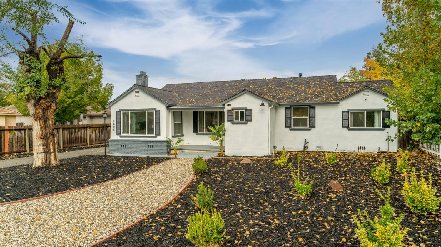 Charming ranch-style cottage sits on an oversized 1/3-acre corner lot in a desirable neighborhood! T