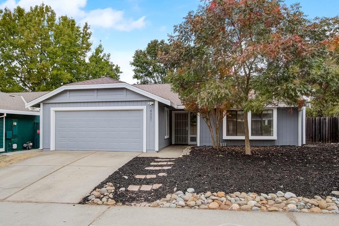 This Carmichael one-story corner home offers a patio, quartz countertops, and a two-car garage.