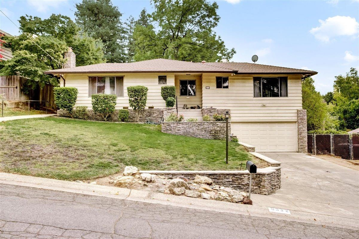 Beautifully remodeled contemporary mid-century home located in established Fair Oaks Chicago Heights