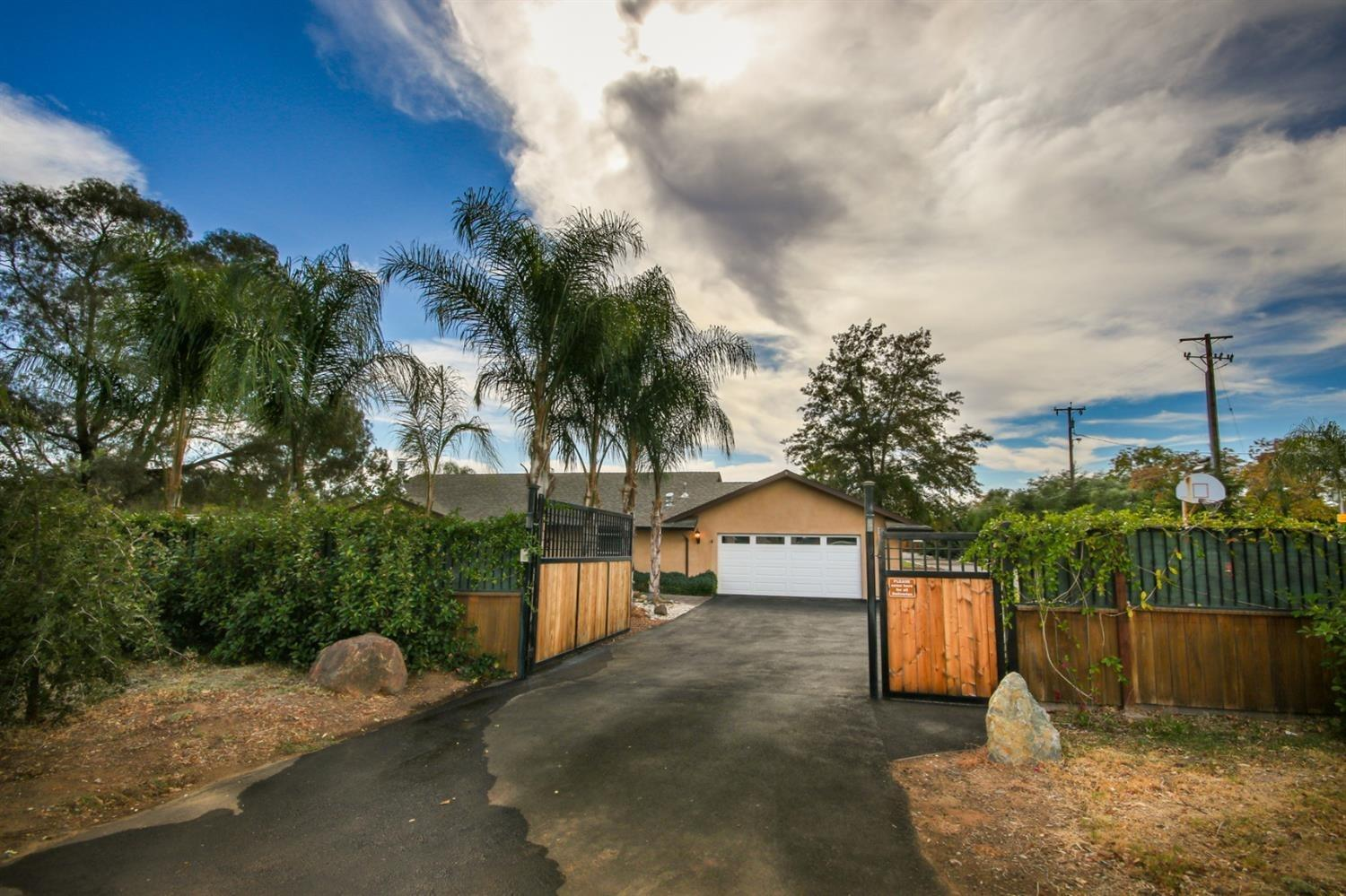 RARE OPPORTUNITY - 2 HOMES plus a Casita on 1 ACRE LOT (.96 ac) with POOL! **MAIN HOUSE is updated 2162 sqft, 3 bed/2 bath PLUS 380 sqft 1 bed/1 bath CASITA. *GUEST HOUSE is 1296 sqft 2 bed/1 bath with full Kitchen, indoor laundry, large covered front patio & private fully gated backyard next to Large 17' x 26' WORKSHOP. Privacy fencing around property with remote gate entry for each house. Property features a Large custom 26,000 gal PebbleTec Salt Water POOL, private 8 person free standing SPA, extensive stamped concrete, multiple covered patios with electrical & ceiling fans, small ORCHARD with 23 different types of fruits, KOI Pond, 2 separate RV hookups, plenty of parking w/ AMAZING landscaping. Ultimate rural seclusion yet close to award winning Schools and all the restaurants, shopping, recreation and amenities West Roseville has to offer. Only 25 min to SMF Airport and Midtown Sacramento. Too many details to list!